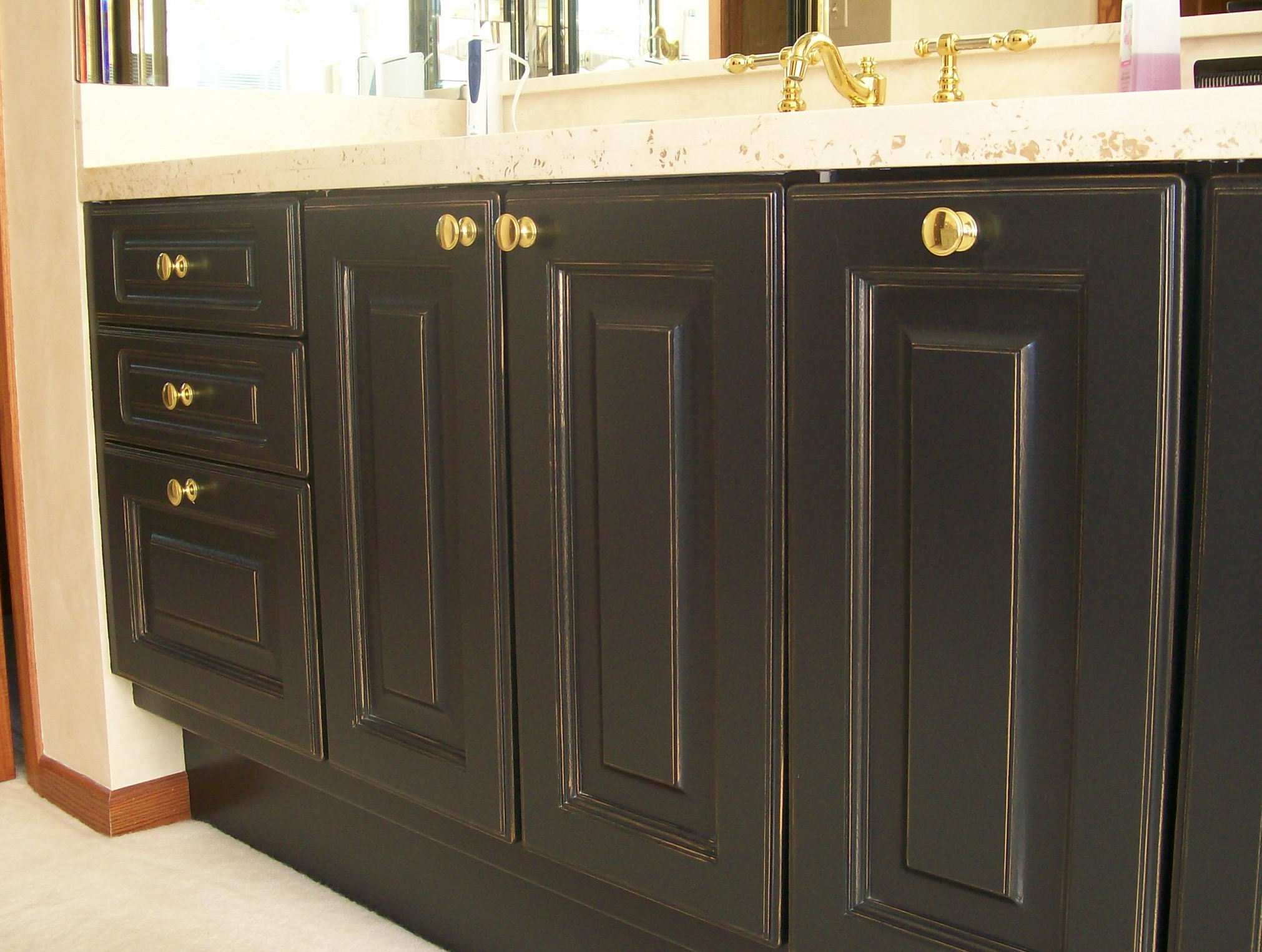 refinished cabinets with gold touches