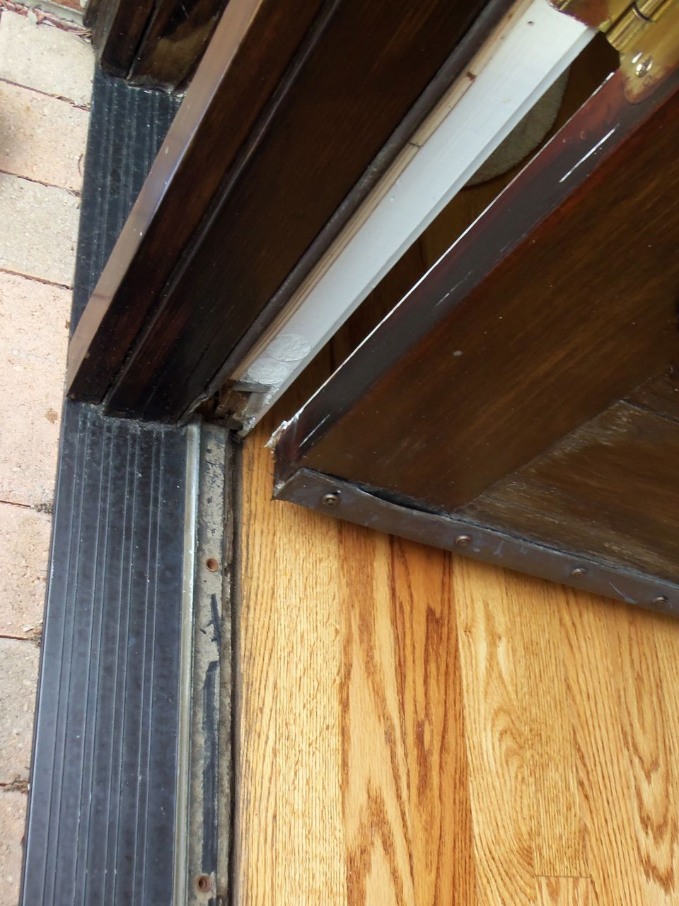 Checking wood door s weather stripping saves money for Door weather stripping