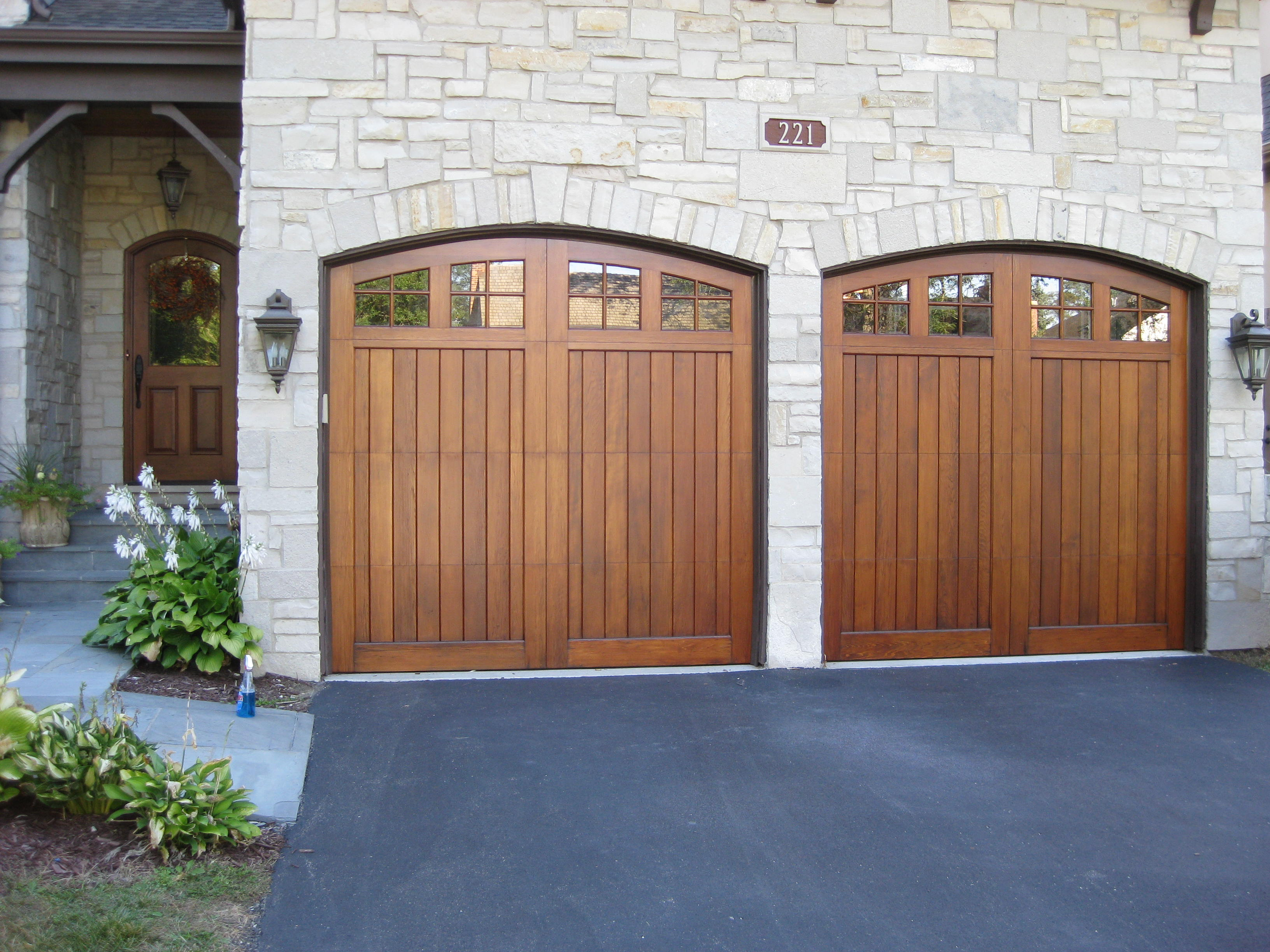Deciding on refinishing wood garage doors the milky look for Wood looking garage doors