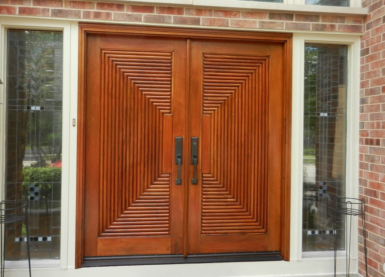 Another set of wood front doors rescued from the brink for Exterior wooden door designs