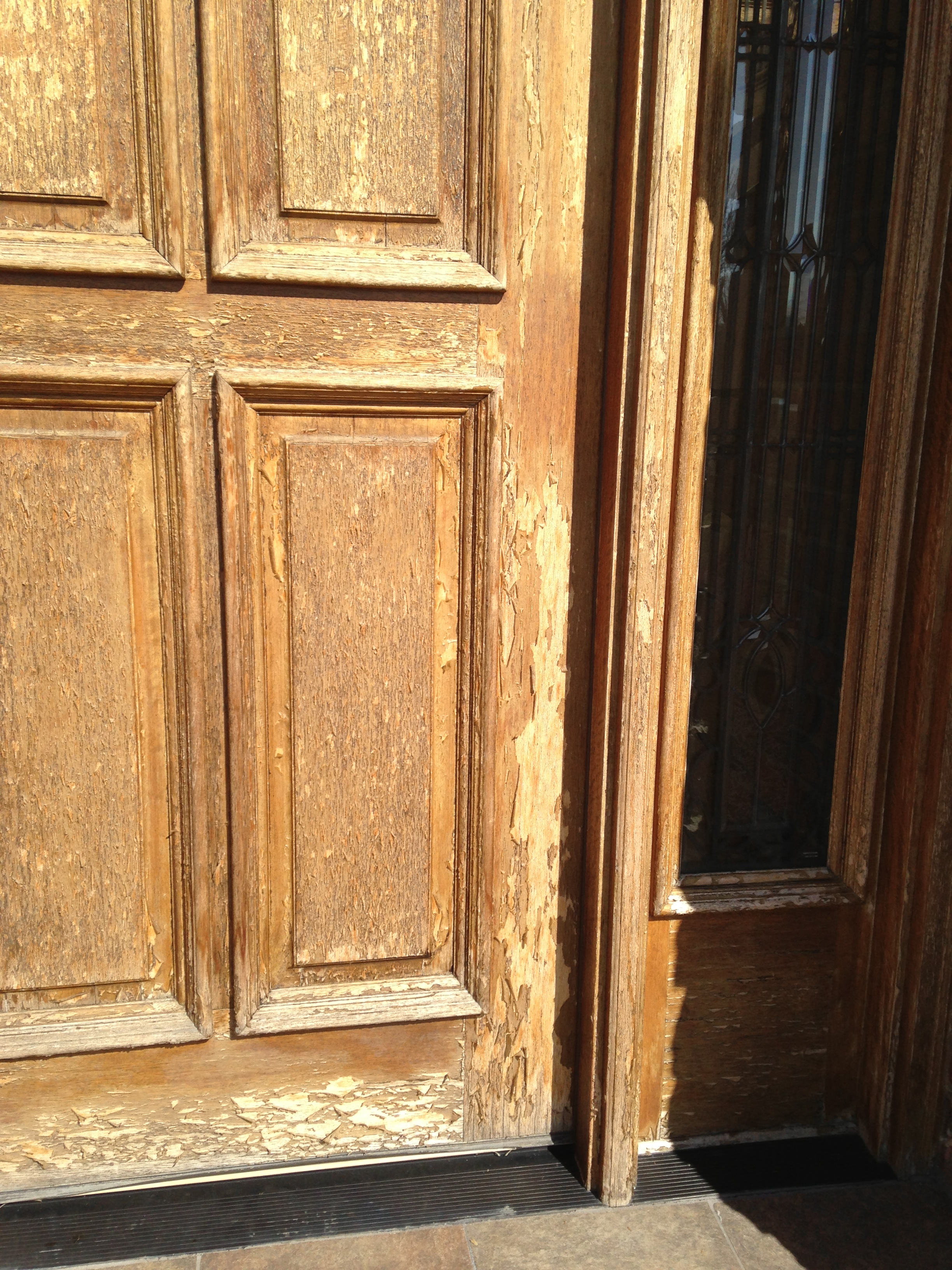 failed coating on wood front door