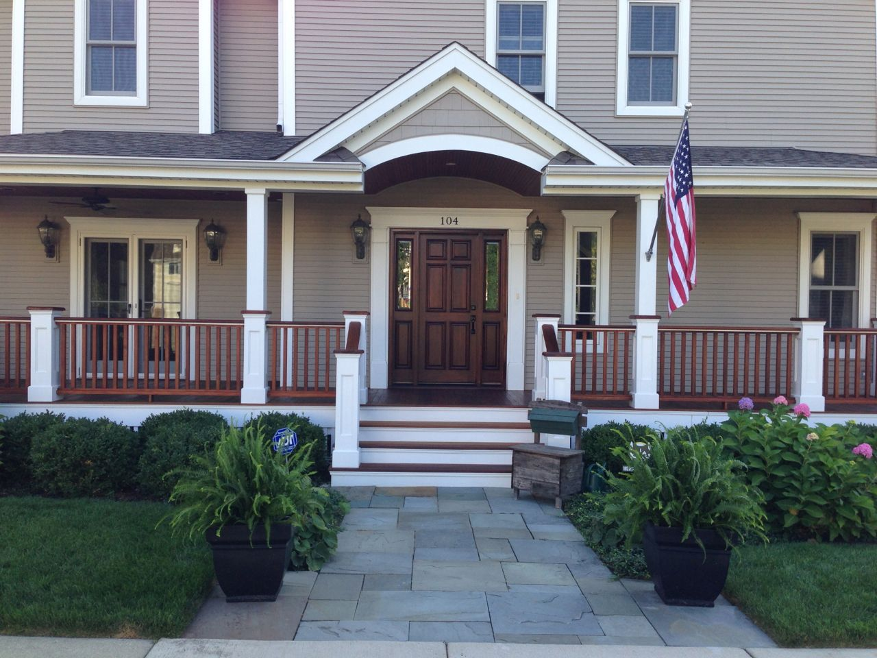 The refinishing of an ipe wood front porch floor for Flooring for porches
